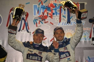 Adrian Fernandez, left, and his racing teammate, Luis Diaz, savor their win at the 12 Hours of Sebring Race on March 21 in Florida