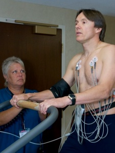 Patti Miller, RN, guides Adrian Fernandez through his cardiac screening